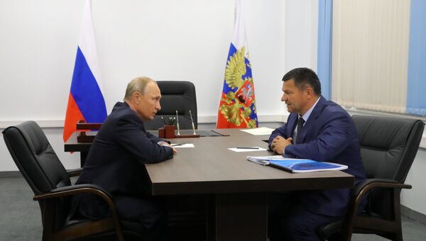 Президент РФ Владимир Путин и временно исполняющий обязанности губернатора Приморского края Андрей Тарасенко