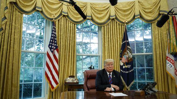 Президент США Дональд Трамп в Овальном кабинете Белого дома в Вашингтоне. 27 августа 2018 года