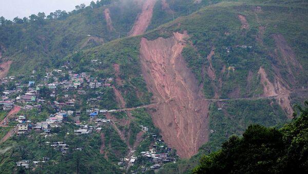 Последствия тайфуна Мангхут в городе Итогоне на Филиппинах. 16 сентября 2018 года