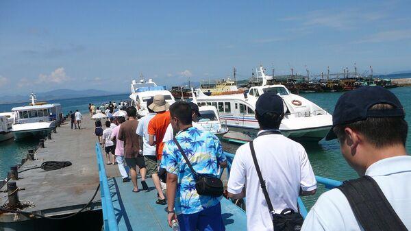Туристы в провинции Хайнань в Китае