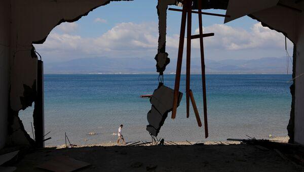 Последствия землетрясения в городе Палу, на острове Сулавеси в Индонезии. 1 октября 2018 года