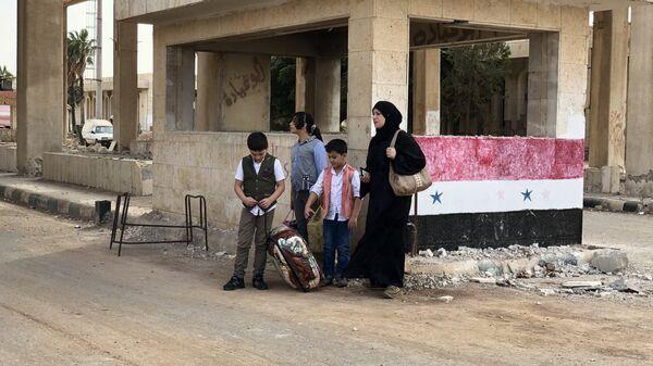 Женщина с детьми в Сирии