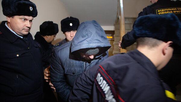 Бывший сотрудник полиции Эдуард Матвеев, обвиняемый в изнасиловании девушки-дознавателя, во время рассмотрения ходатайства следствия об аресте в Кировском районном суде Уфы. 2 ноября 2018