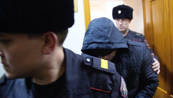Бывший сотрудник полиции Эдуард Матвеев, обвиняемый в изнасиловании девушки-дознавателя, во время рассмотрения ходатайства следствия об аресте в Кировском районном суде Уфы. Архивное фото