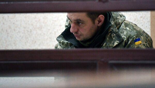 Задержанный командир дивизиона судов обеспечения военно-морской базы Юг ВМС Украины Владимир Лесовой в суде Симферополя. 28 ноября 2018