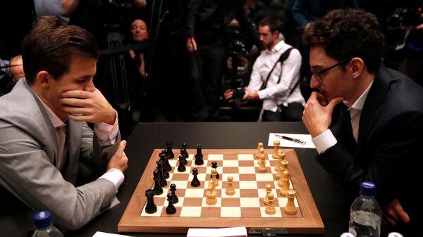 Магнус Карлсен и Фабиано Каруана (слева направо)