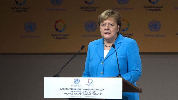 Канцлер Германии Ангела Меркель во время выступления на конференции ООН по миграции в марокканском городе Марракеш. 10 декабря 2018