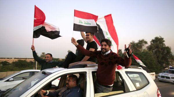 Иракцы празднуют годовщину освобождения от ИГ (запрещена в РФ) в Зеленой зоне в центре Багдада