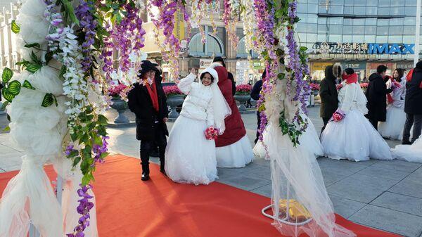 Групповая свадебная церемония в Харбине, Китай. 6 января 2019