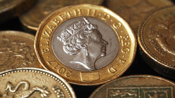 Монеты Великобритании номиналом один фунт стерлингов