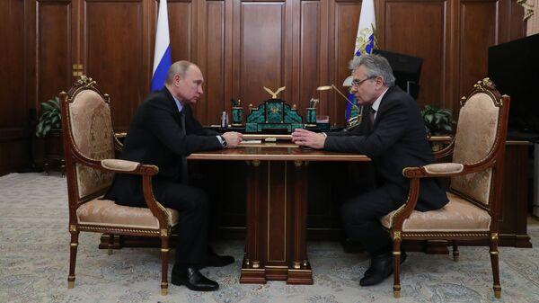 Президент РФ Владимир Путин и президент РАН Александр Сергеев во время встречи. 9 января 2019