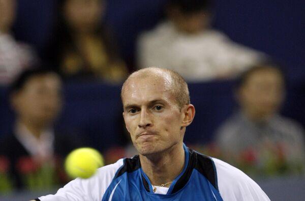 Николай Давыденко в матче против дель Потро на итоговом турнире ATP в Шанхае