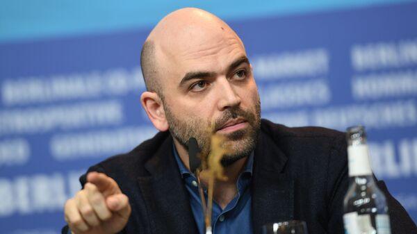 Писатель и журналист Роберто Савиано на пресс-конференции, посвященной показу фильма Пираньи Неаполя