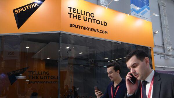 Стенд международного информационного агентства и радио Sputnik на Российском инвестиционном форуме в Сочи