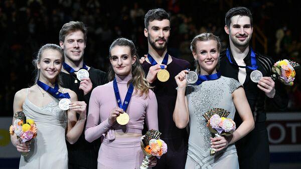 Виктория Синицина и Никита Кацалапов, Габриэлла Пападакис и Гийом Сизерон, Мэдисон Хаббелл и Захари Донохью (слева направо)
