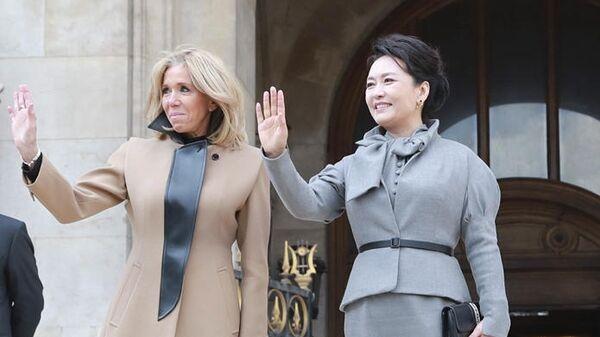 Пэн Лиюань и первая леди Франции вместе посетили Оперу Гарнье в Париже