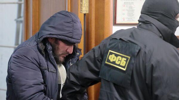 Член бандгруппы Магомедали Вагабова, причастной к терактам в московском метро, Магомед Нуров перед началом заседания суда города Москвы. 28 марта 2019