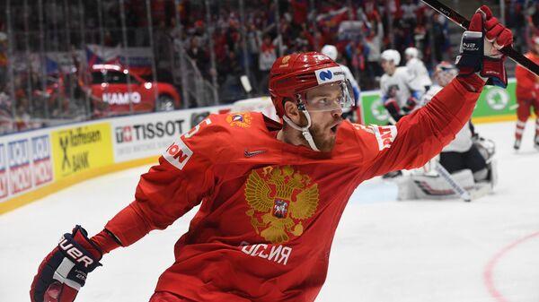 Форвард сборной России Михаил Григоренко радуется заброшенной шайбе
