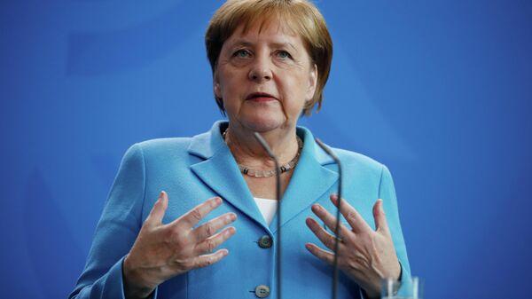 Канцлер Германии Ангела Меркель выступает во время пресс-конференции с премьер-министром Финляндии Антти Ринне в Берлине. 10 июля 2019