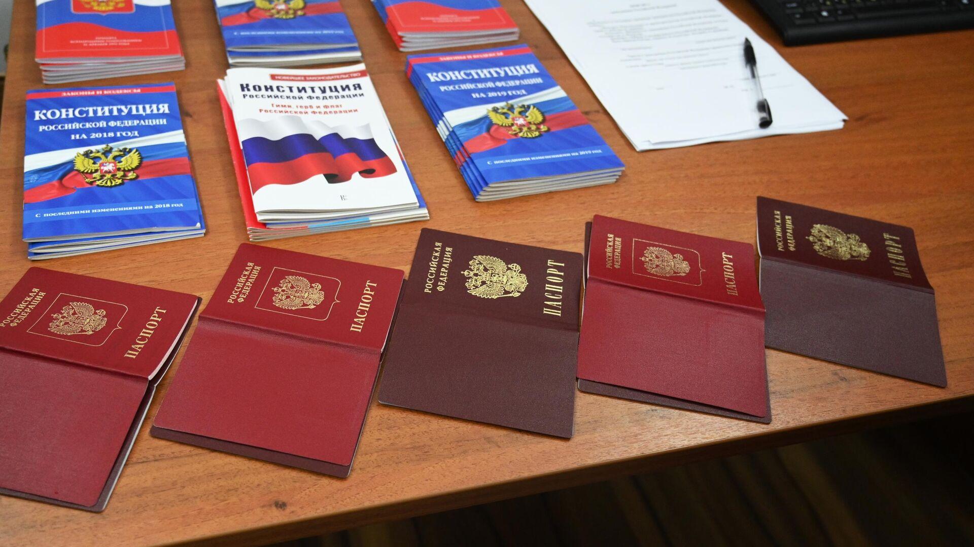 Выдача российских паспортов гражданам ДНР и ЛНР - РИА Новости, 1920, 16.03.2021