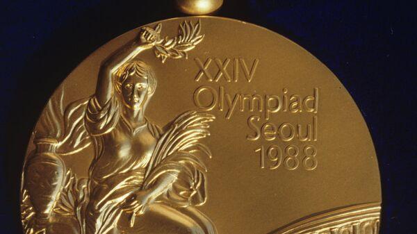 Золотая медаль XXIV Летних Олимпийских игр в Сеуле.