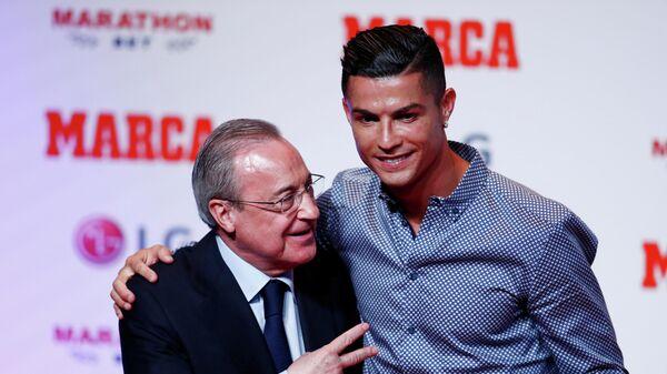 Криштиану Роналду и президент Реала Флорентино Перес (слева)