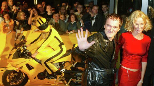 Режиссер Квентин Тарантино и актриса Ума Турман на премьере фильма Убить Билла в Берлине. 1 октября 2003 года
