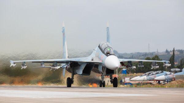 Истребители Су-27 ВКС России на авиабазе Хмеймим в Сирии