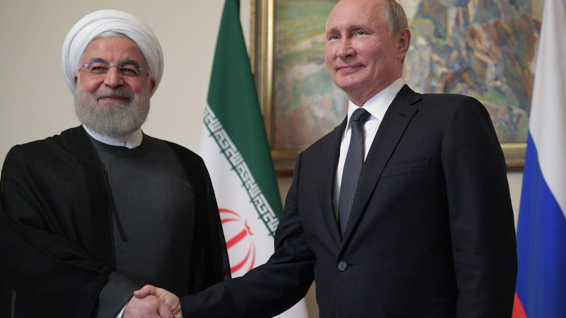 Президент РФ Владимир Путин и президент Исламской Республики Иран Хасан Роухани во время встречи в рамках саммита ЕАЭС - РИА Новости, 1920, 29.02.2020