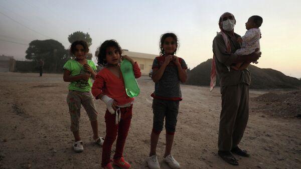 Жители сирийского города Рас эль-Айн