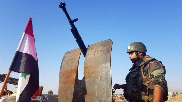 Сирийские военные в населенном пункте Телль-Тамер в 30 километрах от границы с Турцией