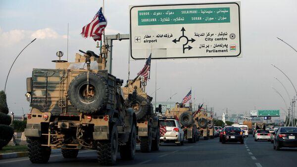 Колонна американских военных автомобилей на территории Ирака после вывода из Северной Сирии
