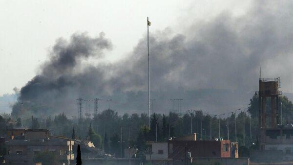 Дым над городом Телль-Абьяд, Сирия