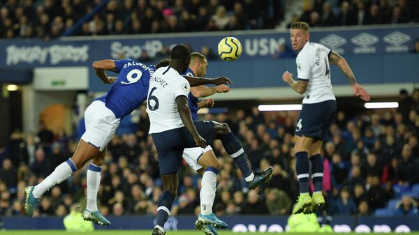 Everton's Turkish striker Cenk Tosun (2R) heads the ball to score their first goal to equalise 1-1 during the English Premier League football match between Everton and Tottenham Hotspur at Goodison Park in Liverpool, north west England on November 3, 2019. (Photo by Oli SCARFF / AFP) / RESTRICTED TO EDITORIAL USE. No use with unauthorized audio, video, data, fixture lists, club/league logos or 'live' services. Online in-match use limited to 120 images. An additional 40 images may be used in extra time. No video emulation. Social media in-match use limited to 120 images. An additional 40 images may be used in extra time. No use in betting publications, games or single club/league/player publications. /