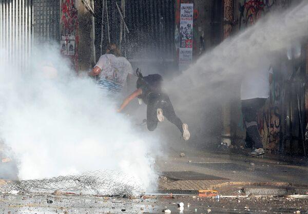 Акция протеста против правительства Чили в Сантьяго