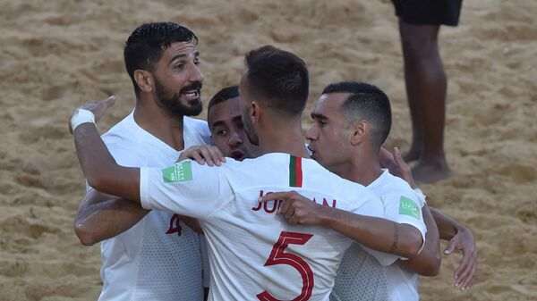 Portugal's players celebrates after scoring against Italy during their final FIFA Beach Soccer World Cup Paraguay 2019 football match at Los Pynandi stadium in Luque, Paraguay on December 1, 2019. (Photo by NORBERTO DUARTE / AFP)