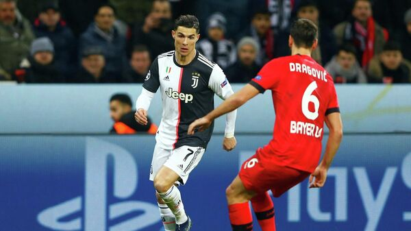 Soccer Football - Champions League - Group D - Bayer Leverkusen v Juventus - BayArena, Leverkusen, Germany - December 11, 2019  Juventus' Cristiano Ronaldo in action with Bayer Leverkusen's Aleksandar Dragovic   REUTERS/Thilo Schmuelgen