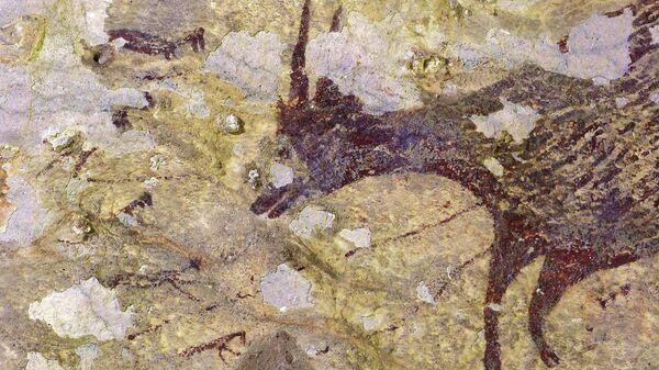 Пещерная живопись, датируемая возрастом 44 000 лет,  найденная в известняковой пещере на острове Сулавеси, Индонезия