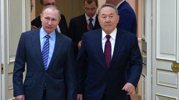 Президент РФ Владимир Путин и первый президент Республики Казахстан Нурсултан Назарбаев