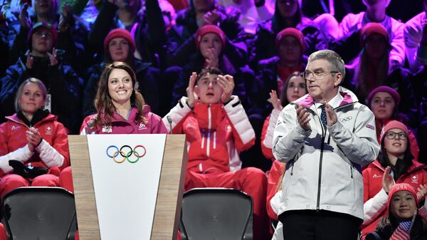 Президент Оргкомитета Лозанна-2020 Виржини Февр (слева) и президент Международного олимпийского комитета (МОК) Томас Бах на церемонии открытия зимних юношеских Олимпийских игр 2020 года
