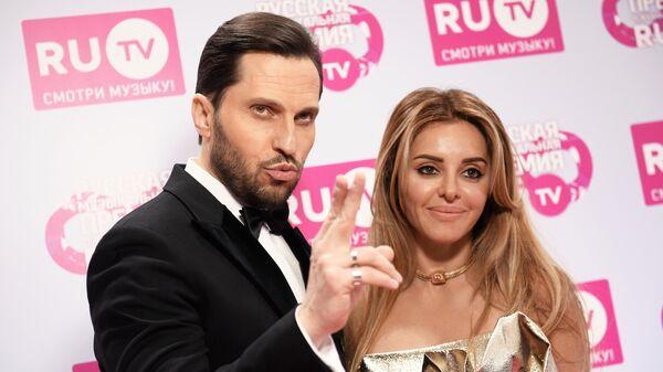 Актер, шоумен Александр Ревва с супругой Анжеликой