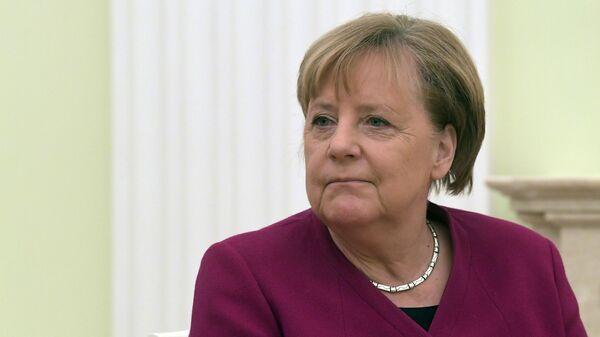 Федеральный канцлер Германии Ангела Меркель во время встречи с президентом РФ Владимиром Путиным