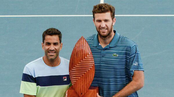 Слева направо: теннисисты Максимо Гонсалес (Аргентина) и Фабрис Мартен (Франция)
