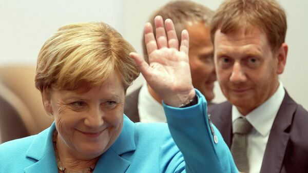 Канцлер Германии Ангела Меркель и премьер-министр Саксонии Михаэль Кречмер