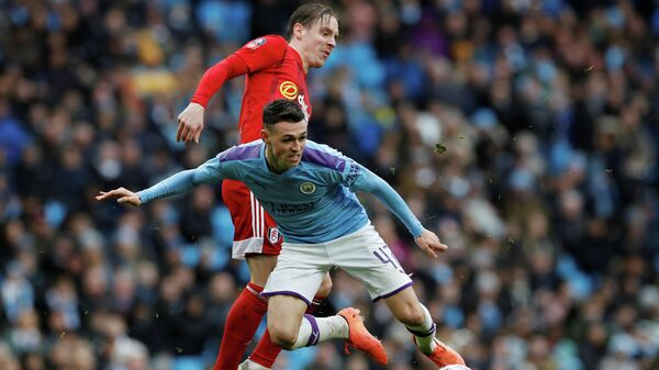 Soccer Football - FA Cup Fourth Round - Manchester City v Fulham - Etihad Stadium, Manchester, Britain - January 26, 2020  Manchester City's Phil Foden in action with Fulham's Stefan Johansen   REUTERS/Phil Noble