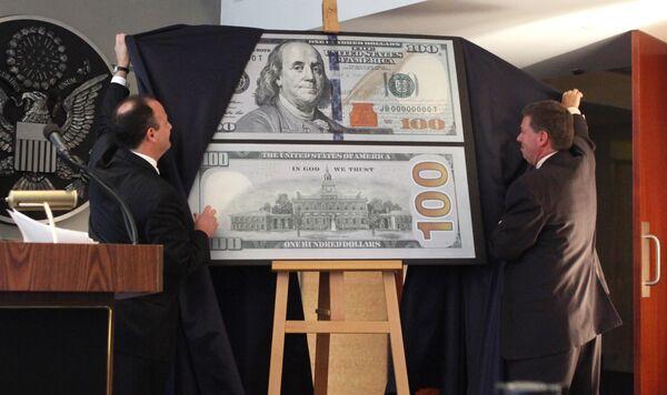 Презентация обновленного дизайна 100-долларовой банкноты