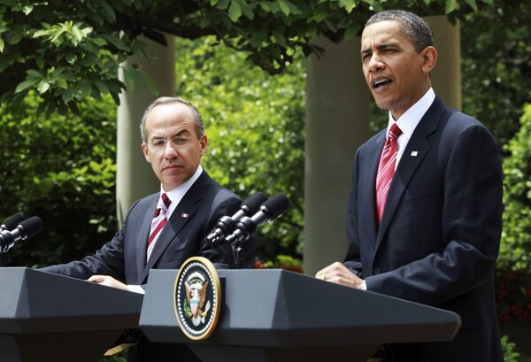 Барак Обама выступает на совместной с президентом Мексики Фелипе Кальдероном пресс-конференции в Розовом саду Белого дома