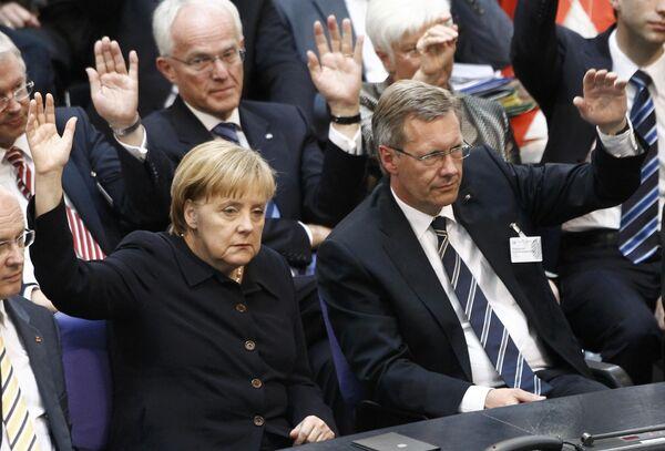 Ангела Меркель и Кристиан Вульф во время выборов президента Германии