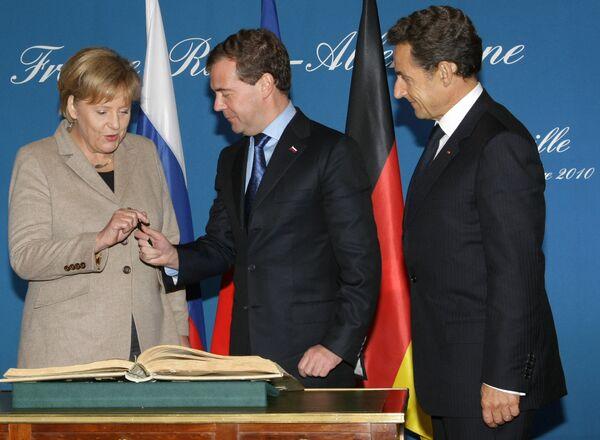 Лидеры России, Франции и Германии в Довиле