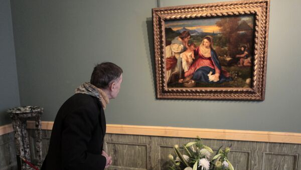 Картина Тициана Мадонна с кроликом в Эрмитаже